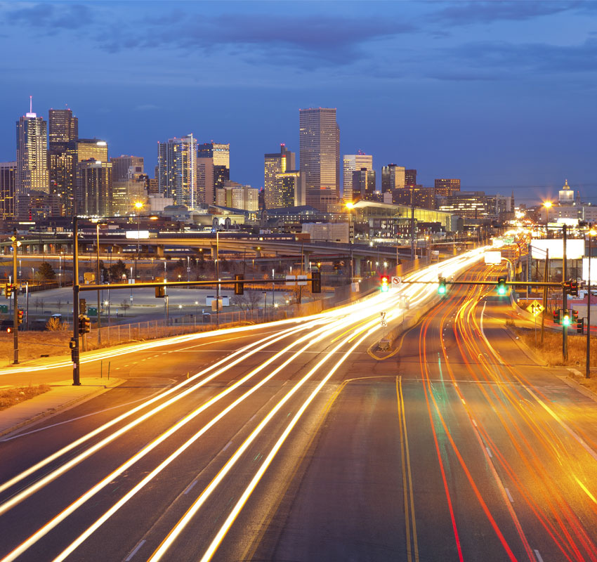 Image of Denver and busy street with traffic leading to the city.
